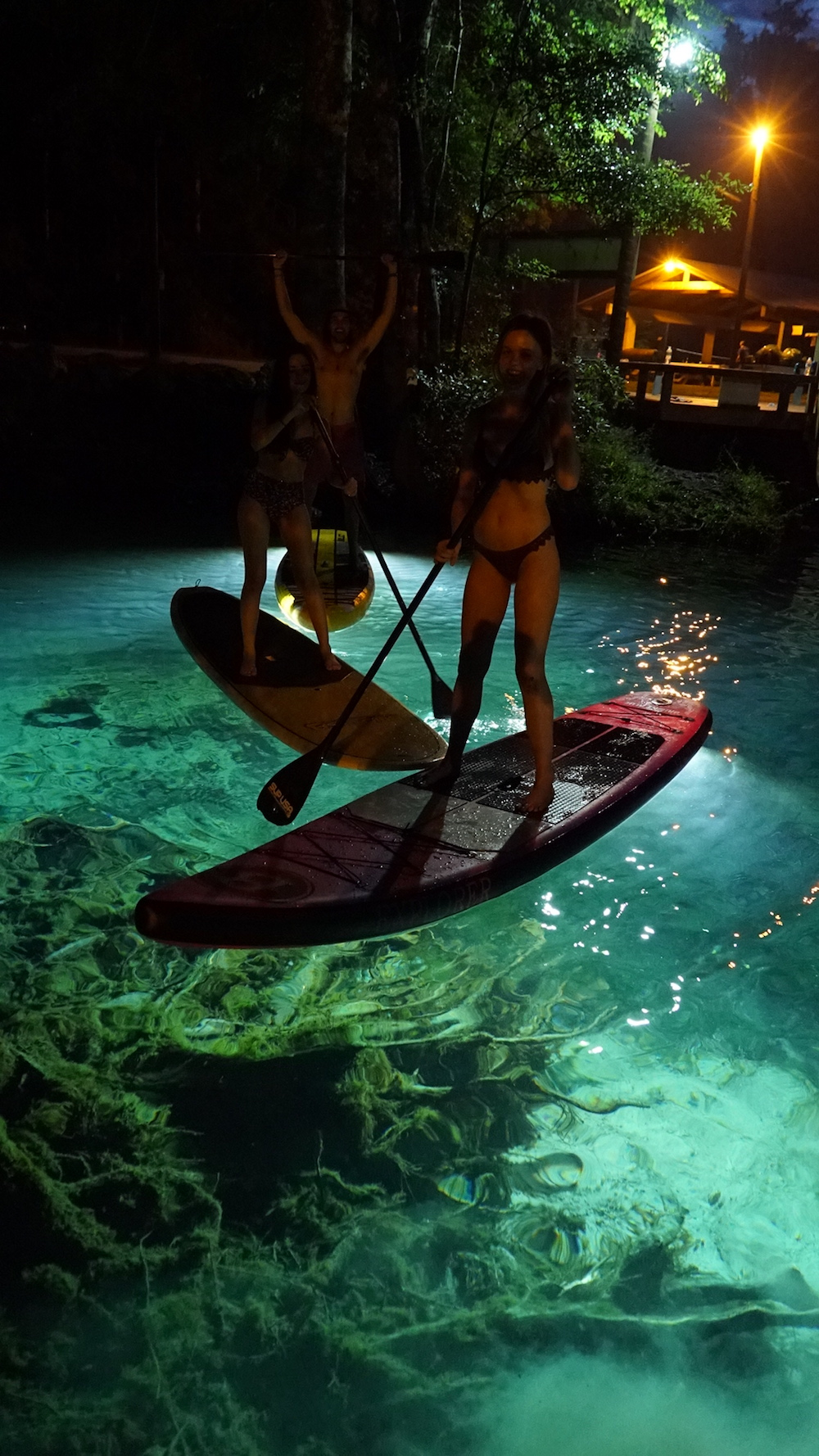 paddle boarding at night