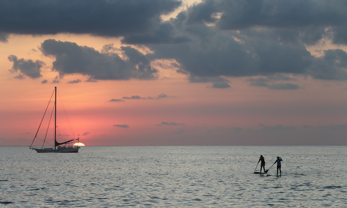 paddle boarding costa rica sunset