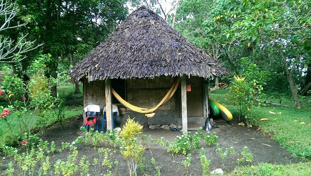 basic thatched huts for travellers to matantas villlage espiritu santo vanuatu