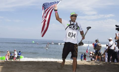 USA's Danny Ching, crossing the finish line placing first and earning the Gold Medal in his ISA debut in the SUP Long Distance Race. Photo: ISA/Bielmann