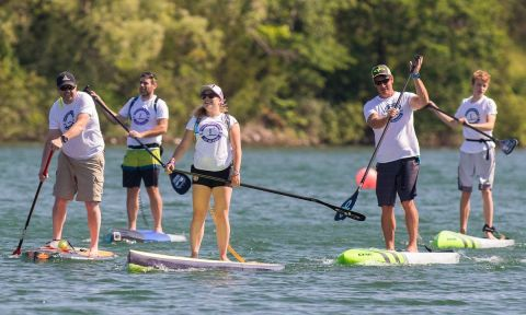 Madeline LeBlanc (center) paddling for Cancer at 2017's On Board. | Photo via Madeline LeBlanc