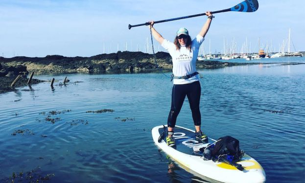 A visibly stoked Sian Sykes after finishing her circumnavigation of Anglesey. | Photo via: Sian Sykes