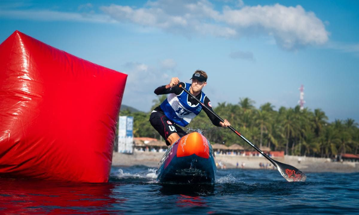 ISA and Pan Am SUP Gold Medalist Connor Baxter (USA) rounds a buoy at the 2019 ISA World SUP and Paddleboard Championship in El Salvador. | Photo: ISA / Sean Evans