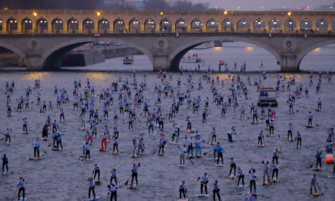 Early morning start at the 6th Annual Nautic SUP Crossing in Paris. | Photo via: Nautic SUP Crossing.com