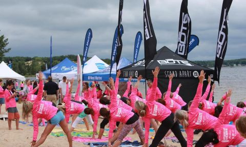 Participants take part in a yoga exercise at Standup for the Cure's 2016 Muskegon event.