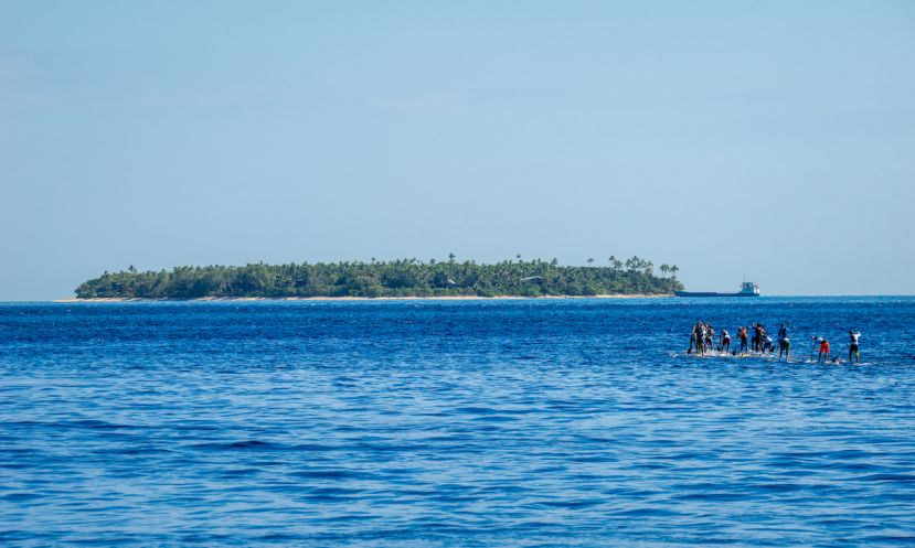 The Men's SUP Paddleboard Distance Race takes off towards the second buoy at Tavarua. | Photo: ISA / Sean Evans