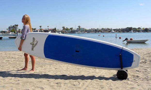 CorSurf's paddle board cart makes it easy to carry your heavy board! | Photo: Andy Gossett