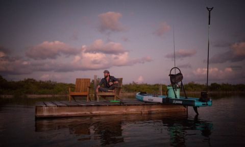 Corey Cooper enjoying sunset from the BOTE House Belize. | Photo Courtesy: BOTE / Sean Murphy