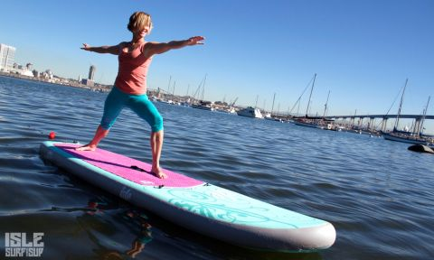 Helen Cloots demonstrates the Warrior 2 Yoga Pose on her Isle Surf and SUP inflatable paddle board.