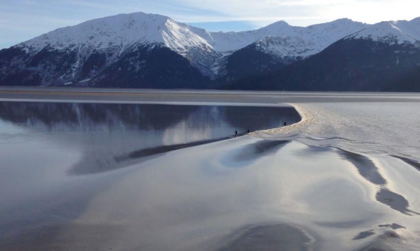 Paddle Boarding The Tidal Bore In Turnagain Arm, Alaska