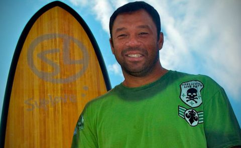 Sunny Garcia, a legend in the surfing world, poses in front of a Suplove stand up paddle board. Photo Coutersy: Suplove