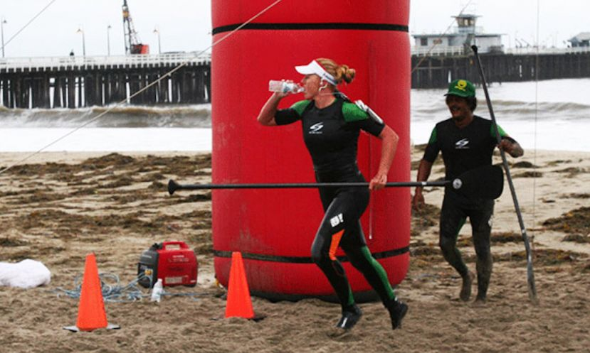 Candice Appleby going for the last beach run with Anthony Vela cheering her on in Santa Cruz, California.