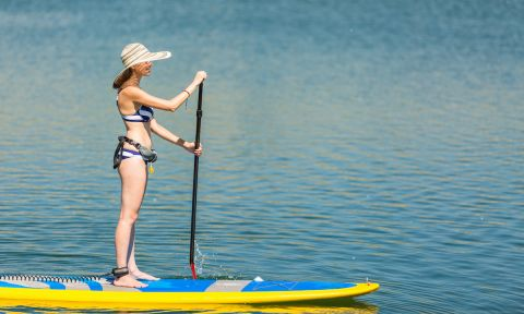 Hats are always helpful when paddle boarding. | Photo: Shutterstock