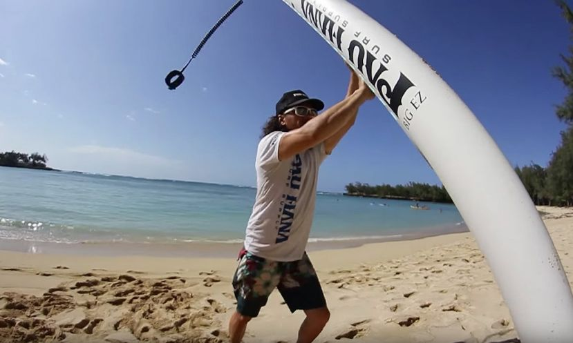Todd Caranto of Pau Hana SUP demonstrating how to lift a stand up paddle board.