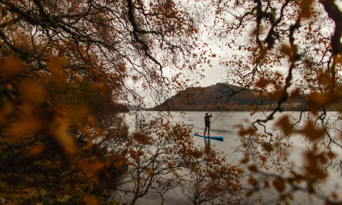 Paddling through the Autumn colours of Loch Ruthven, Scotland. | Photo: Johny Cook
