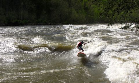 Spenser Lacy surfing the New River Dries on the Badfish River Surfer. | Photo: Randy Fisher