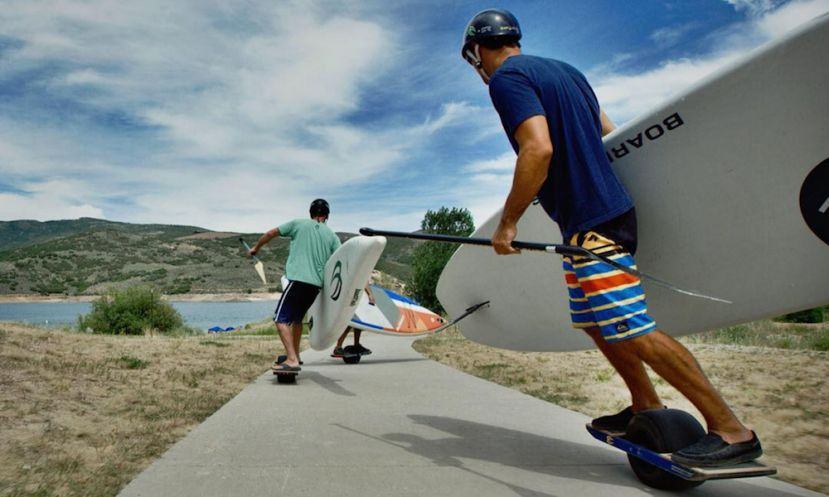 Paddle Boarding Pros Conquer The Onewheel