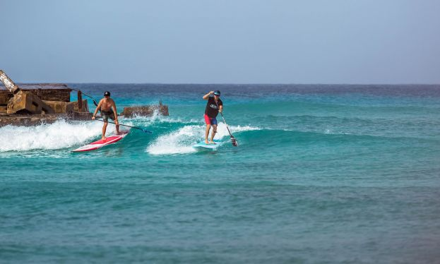 Connor Bonham and Matt Hite share a wave in Barbados. | Photo Courtesy: BIC SUP