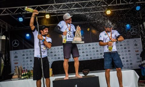 Michael Booth getting a champagne shower atop the podium in Germany. | Photo: Georgia Schofield
