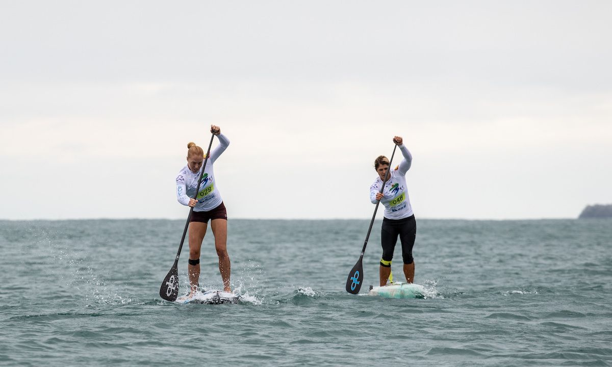 Candice Appleby (left) on her way to taking Gold in the Technical Race at the 2018 ISA World SUP and Paddleboard Championship in Hainan, China. Photo: ISA / Pablo Jimenez