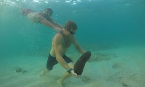 Chuck Glynn underwater strength training...with a little assistance. | Photo via: The Ultimate Waterman