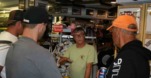 Bob Long (center) talks stand up paddle boards with Boardworks Surf chief operating officer, Bob Rief (right).