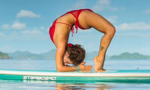 Dashama Gordon, a Starboard SUP ambassador, is a leading voice in the SUP Yoga movement.