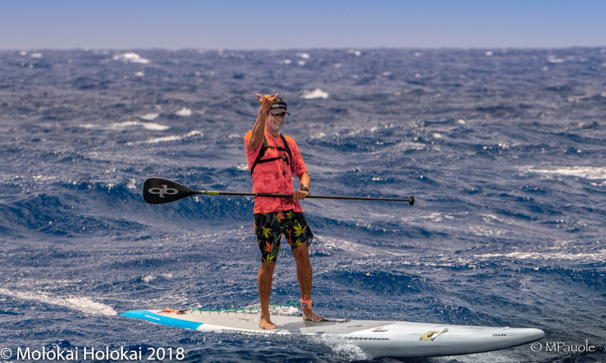 SIC's Livio Menelau throws one up during the 2018 Maui2Molokai Race. | Photo courtesy: Molokai Holokai Paddle Festival