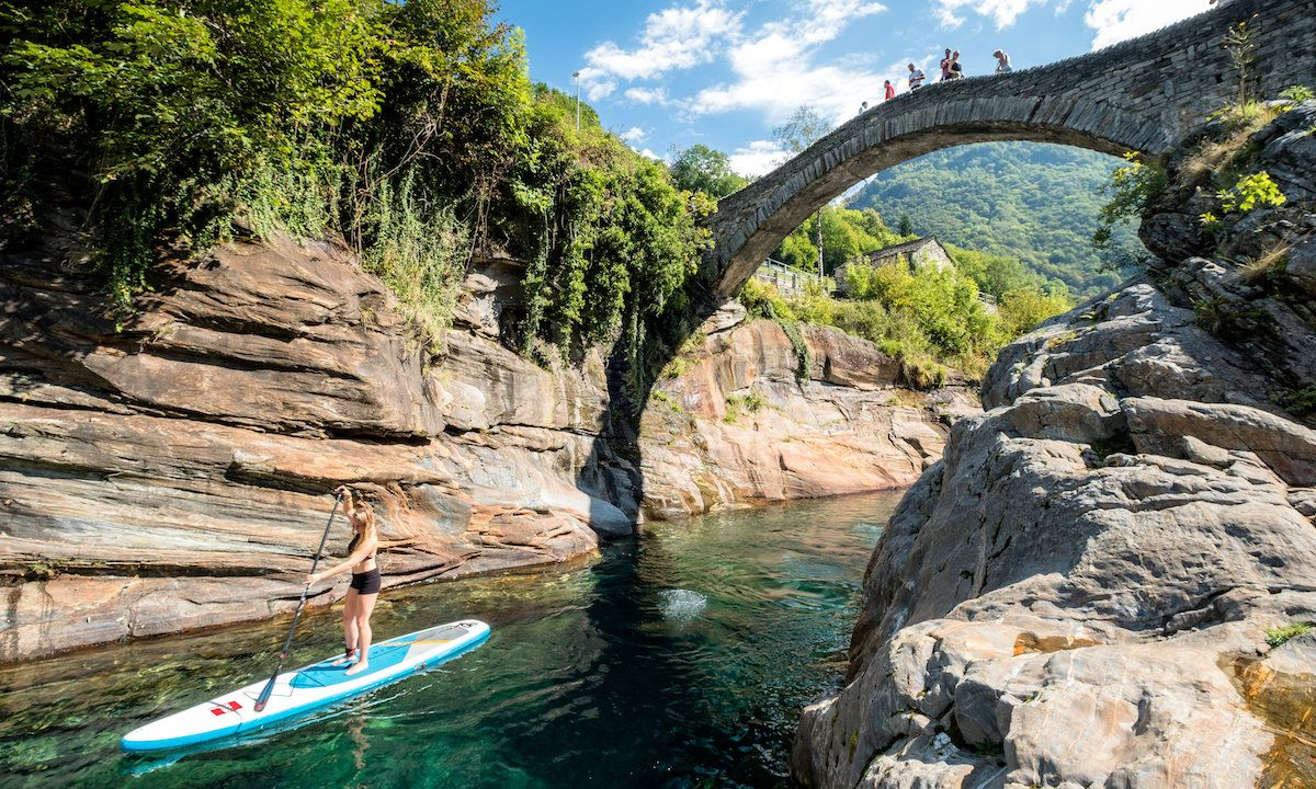 A paddler goes through the Ponte dei Salti in Lavertezzo, Switzerland. | Photo courtesy: Nicholas Spooner
