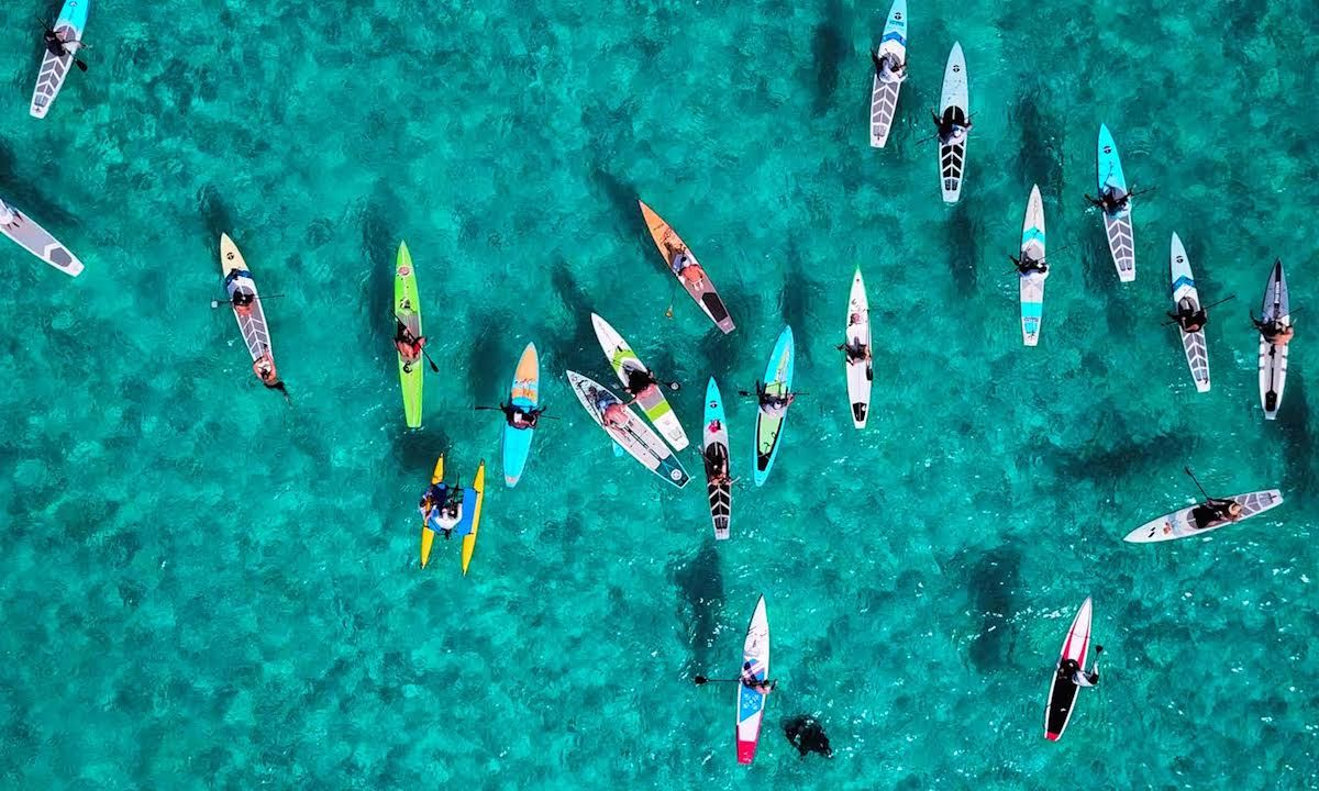 Paddlers assemble in Bimini, in preparation for the 80-mile Crossing For A Cure to Lake Worth Beach, Florida. Jimmy Buffett has signed on as an Advisor to the Board of Piper's Angels Foundation. | Photo Courtesy: Crossing for a Cure