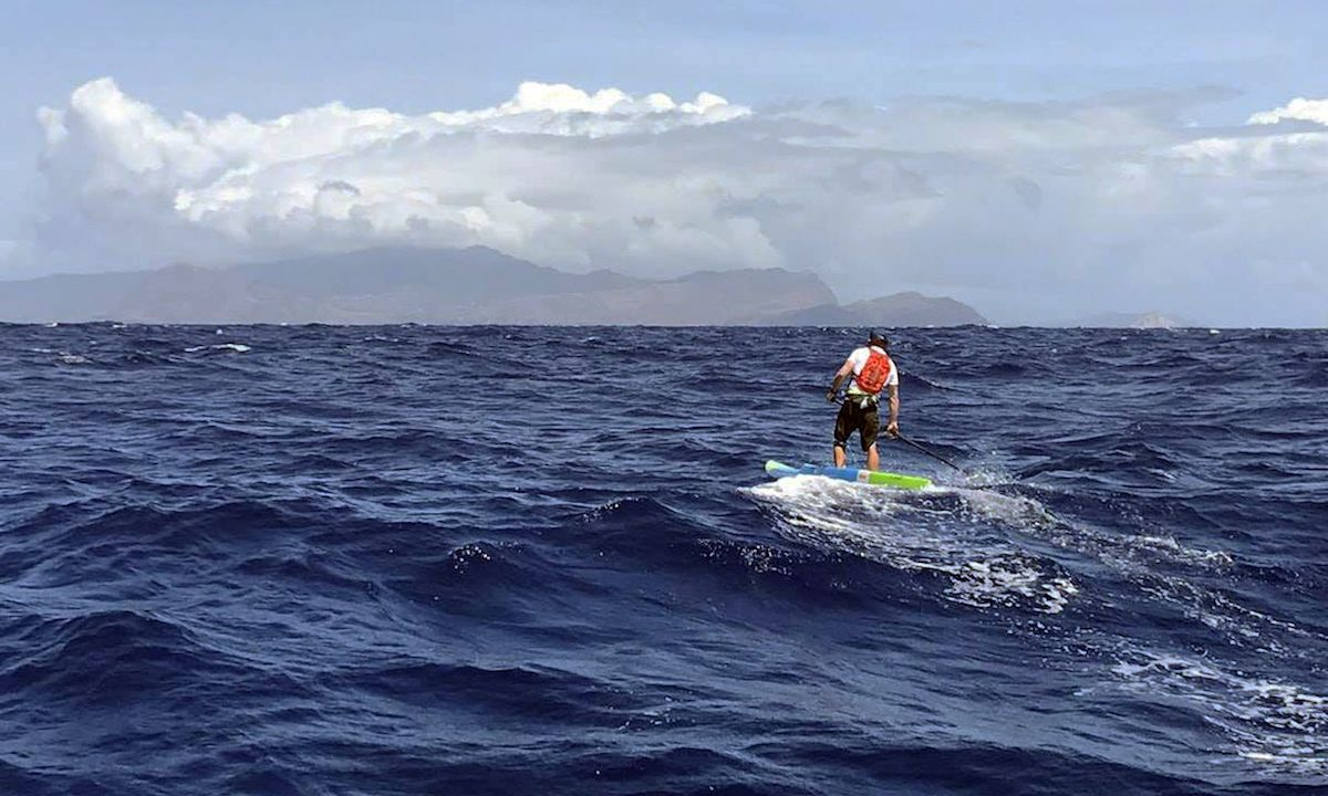 Travis Grant paddling towards Oahu in the distance. | Photo: Blair Grant