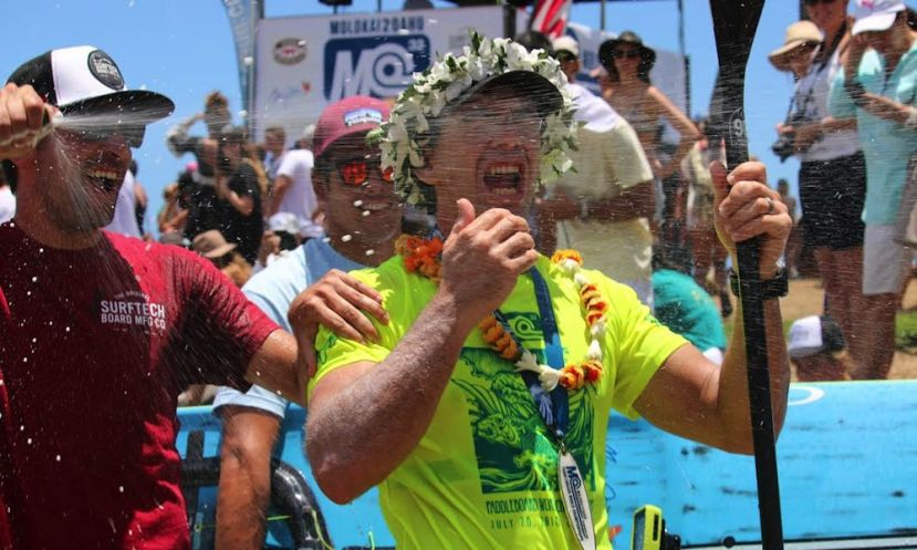 Travis Grant receiving a well-deserved champagne shower after winning the M2O. | Photo Courtesy: NSP
