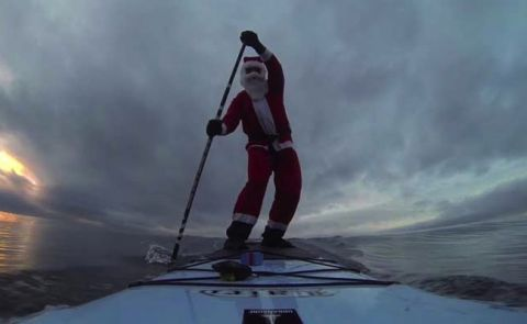 Santa Visits Seattle on a Standup Paddle Board