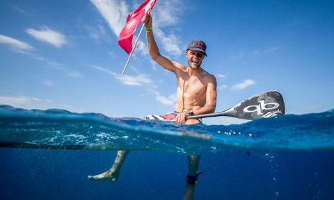 Casper Steinfath soaks in the joy of winning his third Gold Medal in the Men's SUP Technical Race. | Photo: ISA / Ben Reed