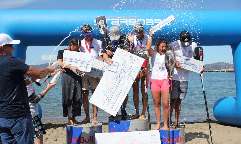 Champagne showers after the 8th Annual Battle of the Bay. | Photo courtesy: OnItPro