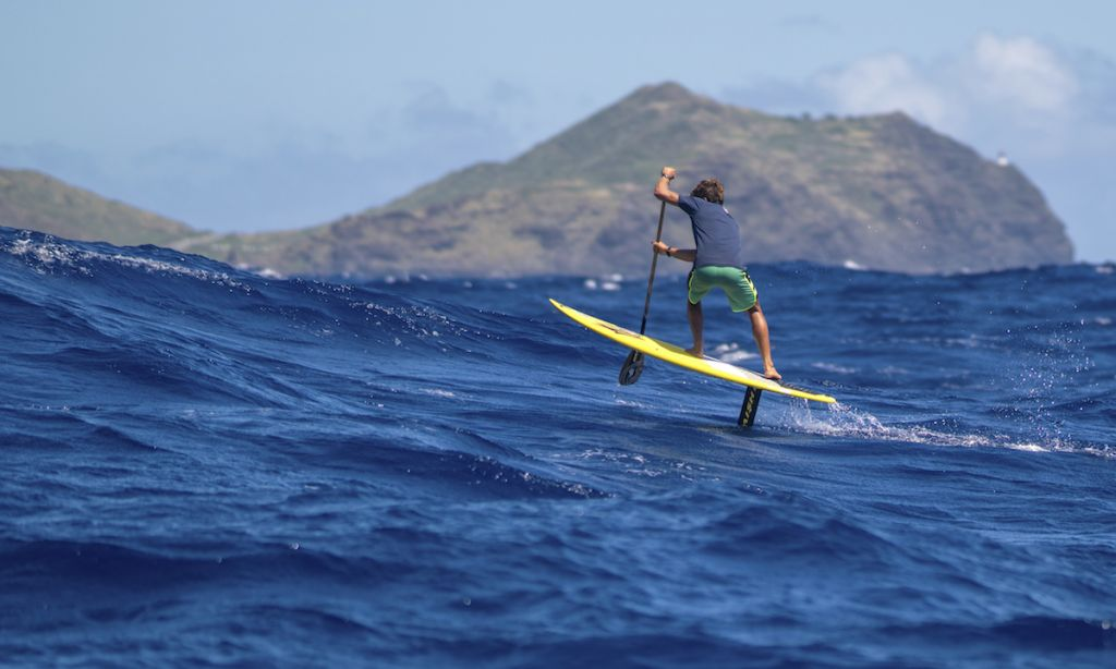 Kai Lenny stand up paddle foiling between Molokai and Oahu. | Photo Courtesy: Red Bull