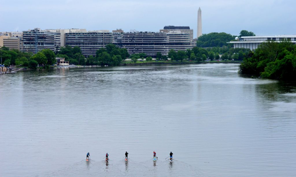 From left to right paddlers Jason Kopp, Maria Schultz, Matt Jones, Kathy Summers and Guillermo Loria begin their journey along the Georgetown Waterfront in DC. | Photo: Deb Stipa