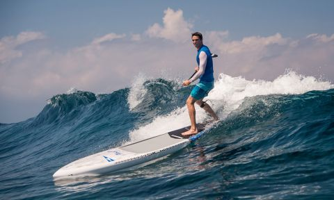 Kody Kerbox SUP surfing off the coast of Maui, Hawaii.