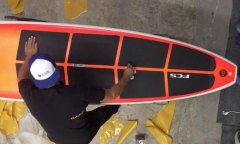 Ryan demonstrates how to install an eight-piece deck pad to your SUP.