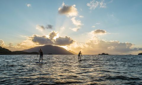 Nikki Gregg and friend paddling in New Caledonia during filming for a Facing Waves episode. | Photo Courtesy: Facing Waves