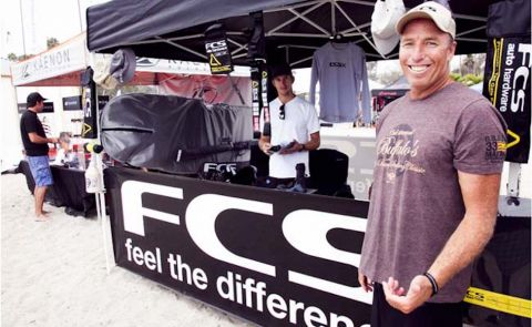 Tyler Callaway, the face of FCS in the US, stands by the FCS booth at the Battle of the Paddle in Dana Point. Photo: Sup Connect.