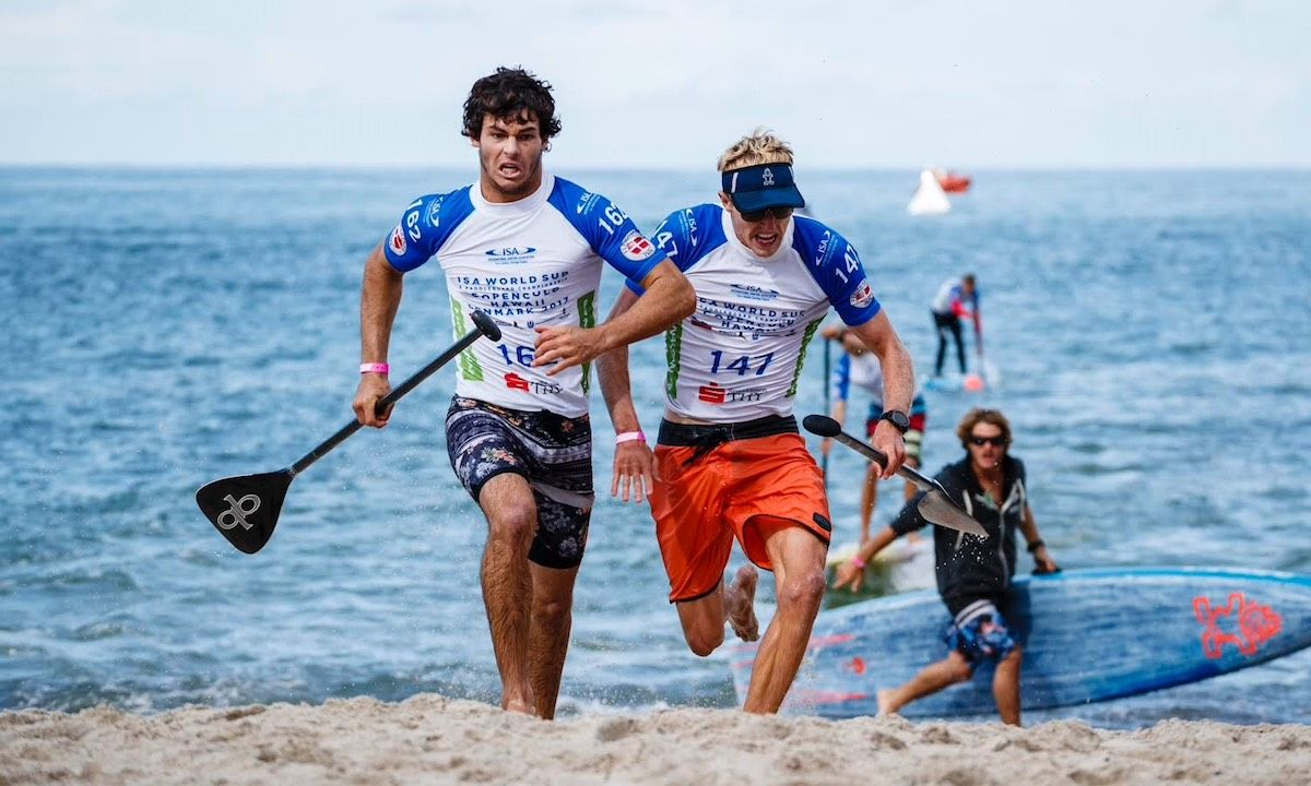 Mo Freitas (left) and Connor Baxter (right) battle at the finish line at ISA World SUP Championships in 2017. | Photo Courtesy: ISA