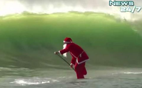 Santa Spotted SUP Surfing!