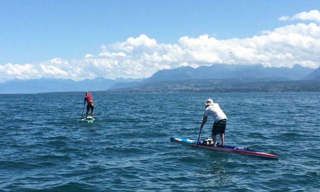 Steeve Fleury and Robert Etienne paddle on lake Léman.