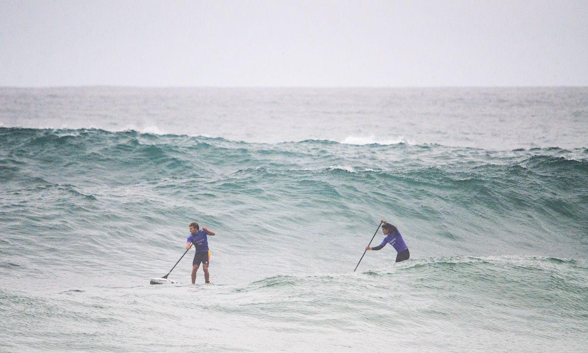 SUP racers navigating the swell. | Photo: Latinwave