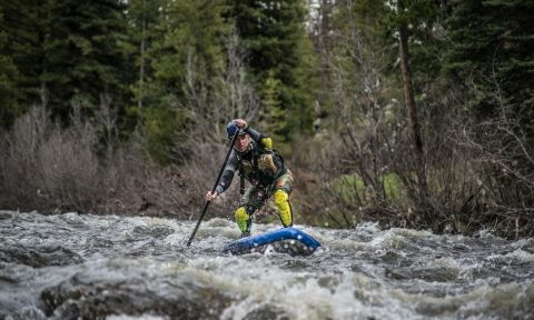 Andrew Smith paddling the Hala Straight Up down the Elk River outside Steamboat Springs, Colorado.