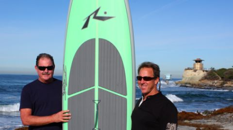 Rusty Preisendorfer and Mike Fox, owner of Boardworks, standing at a well-know sup surf break in San Diego County. Do you know what's called?