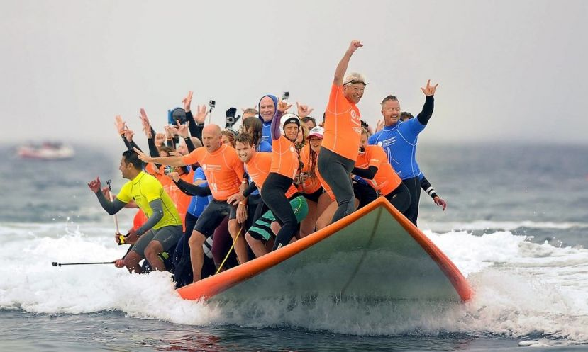 World Record Set For Most Surfers To Ride One Board