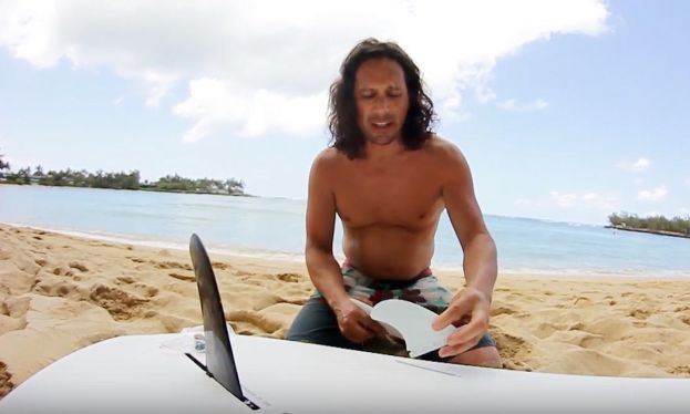 Todd Caranto demonstrates how to install side bite fins into a paddle board.