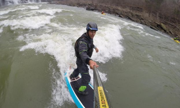 River expert Mike Tavares river surfing. | Photo: Mike Tavares
